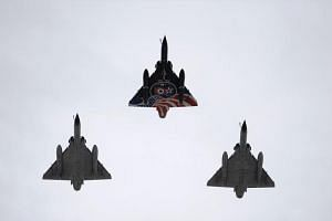 Mirage 2000N jets of the La Fayette squadron fly above during the annual Bastille Day military parade on the Champs-Elysees avenue in Paris on July 14, 2016.