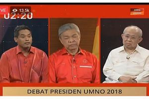 (From left) Umno's outgoing youth chief Khairy Jamaluddin, acting president Ahmad Zahid Hamidi and veteran Tengku Razaleigh Hamzah taking part in the debate on June 29, 2018. Datuk Seri Zahid was participating from Bagan Datuk in Perak.
