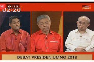 (From left) Umno's outgoing youth chief Khairy Jamaluddin, acting president Ahmad Zahid Hamidi and veteran Tengku Razaleigh Hamzah taking part in the debate on June 29, 2018. Datuk Seri Zahid was participating from Bagan Datuk in Perak.