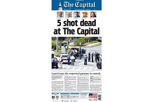 """The front-page headline read """"Five shot dead at The Capital"""", below pictures of the five people killed - four journalists and a sales assistant."""