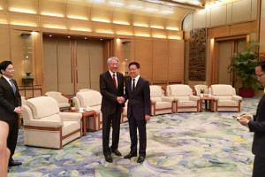 Singapore's Deputy Prime Minister Teo Chee Hean with his new Joint Council for Bilateral Cooperation counterpart, Chinese Vice-Premier Han Zheng, at the Great Hall of the People in Beijing on June 29, 2018.