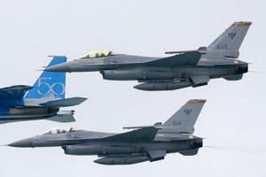 File photo showing two RSAF F-16Cs in an aerial display at the Singapore Airshow, on Feb 7, 2018.
