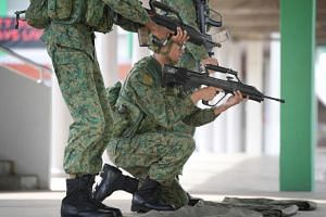 File photo showing recruits undergoing weapon-handling practice with the SAR21 rifle in a training shed at the SAF's Basic Military Training Centre in Pulau Tekong.