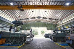 A new hub for tracked vehicles in Sungei Gedong to perform depot-level maintenance tasks in an army camp has reduced manpower costs by 20 per cent.