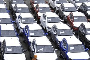 File photo showing cars at a port in Jiangsu province, China. Automakers saw duties on overseas imports almost halved to 15 per cent, on July 1, 2018.