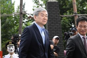 Korean Air chairman Cho Yang-ho arriving at the Seoul Southern District Prosecutors' Office for questioning over suspected tax evasion on June 28, 2018.