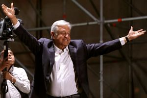 Mexico's newly-elected president Andres Manuel Lopez Obrador gestures to supporters, in Mexico City, Mexico, on July 1, 2018.