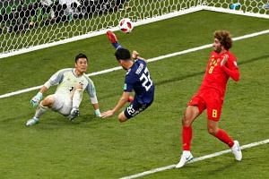 Belgium's Marouane Fellaini (right) in action with Japan's Maya Yoshida and Eiji Kawashima at the Rostov Arena, Rostov-on-Don, Russia, on July 2, 2018.