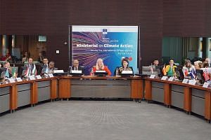Minister for the Environment and Water Resources Masagos Zulkifli, seated with Canada's Minister of Environment and Climate Change Catherine McKenna (in red) at last month's Ministerial on Climate Action.