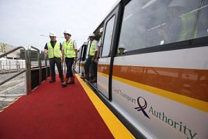Transport Minister Khaw Boon Wan (second from left) was given a tour of the first train during his visit to Mandai Depot on July 4, 2018.