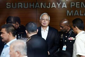 Mr Najib arrives to give a statement to the Malaysian Anti-Corruption Commission in Putrajaya, May 24, 2018.