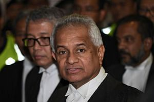 Malaysia's Attorney-General Tommy Thomas (centre) speaking to the media after former Malaysian prime minister Najib Razak appeared before a judge at the Duta court complex in Kuala Lumpur, on July 4, 2018.