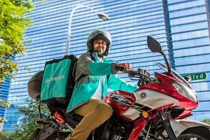 A Deliveroo rider equipped with a halal-only delivery bag, which will be given out to 3,000 riders in phases by the end of July.