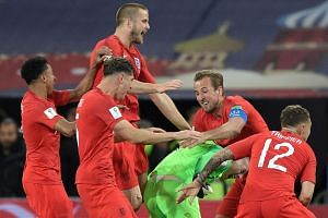 England's players celebrate after the penalty shootout.