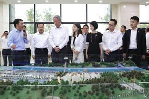 Deputy Prime Minister Teo Chee Hean (third from left) visited the Guoyuan Port in the northern part of Chongqing city to find out more about the hub on July 4, 2018.