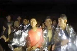 The boys in the Tham Luang cave in a still from a video.