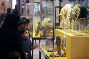 Tourists look at ancient artifacts, returned by Italy, at the Egyptian Museum in Cairo, Egypt, on July 4, 2018.