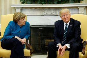 File photo of US President Donald Trump meeting with Germany's Chancellor Angela Merkel in the Oval Office at the White House in Washington, on March 17, 2017.