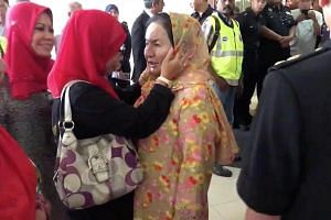 Rosmah Mansor, wife of former Malaysian prime minister Najib Razak, greets relatives in Kuala Lumpur, Malaysia, in a still image taken from a social media video on July 4, 2018.