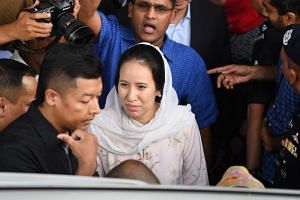 Nooryana Najwa Najib (centre), daughter of former Malaysian prime minister Najib Razak, is surrounded as she leaves the Duta court complex after her father posted bail in Kuala Lumpur on July 4, 2018.