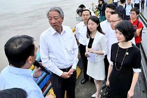 Deputy Prime Minister Teo Chee Hean at Chongqing's Guoyang Port with (from right) Singapore senior parliamentary secretaries Sun Xueling, Tan Wu Meng and Baey Yam Keng (partially obscured).