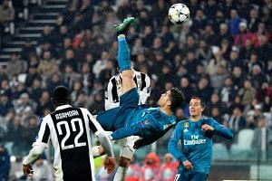 Real Madrid's Portuguese forward Cristiano Ronaldo scoring with an exquisite overhead kick in the 3-0 Uefa Champions League quarter-final first-leg win over Juventus at the Allianz Stadium in Turin on April 3, 2018.