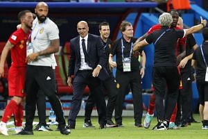 Belgium's head coach Roberto Martinez (centre-left) celebrates after the match.