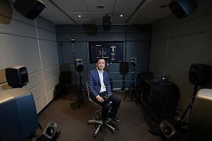 Managing director Ben Breen of design consultancy Space Matrix in a private phone booth at his company. Arup's associate principal acoustic and audiovisual engineer Xu Jingfeng (above) at the firm's SoundLab.