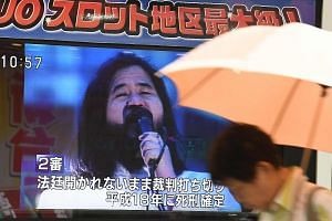 A screen flashing news on the execution of Shoko Asahara, former leader of the Aum Shinrikyo cult, in Tokyo yesterday. He was reportedly the first to be hanged.
