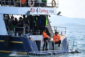 Divers prepare to search an area near Phuket on July 7, 2018, as rescue operations continue for missing tourists following a boat accident on July 5.