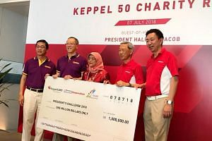 President Halimah Yacob, who received the donation cheque from Keppel chairman Lee Boon Yang (second from right) at the Keppel 50 charity run, said she was heartened by the company giving back to society.