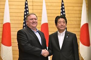 US Secretary of State Mike Pompeo (left) meets with Japan's Prime Minister Shinzo Abe at Abe's official residence in Tokyo on July 8, 2018.