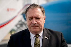 US Secretary of State Mike Pompeo speaking to members of the media before boarding his plane at Sunan International Airport in Pyongyang on July 7, 2018.