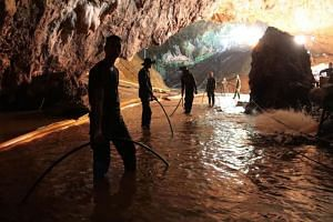 Thai navy soldiers in the flooded Tham Luang cave during rescue operations for the 12 boys and their football team coach trapped in the cave in Chiang Rai province on July 7, 2018.