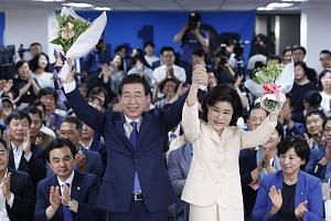 Seoul Mayor Park Won-soon and his wife, Ms Kang Nan-He celebrate with his supporters after he was re-elected for a third term as mayor of the city on June 13. Mr Park has helmed the transformation of South Korea's highly-urbanised capital, which won