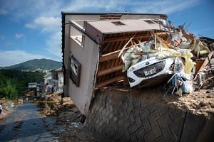 A damaged house in a flood-hit area in Kumano, in Japan's Hiroshima prefecture, is seen on July 9, 2018.