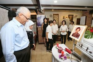 President Halimah Yacob and her husband Mohamed Abdullah Alhabshee at the wake of Mrs Wee Kim Wee on July 8, 2018.