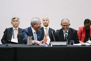 DPM Teo Chee Hean (front left) and Minister for Environment and Water Resources Masagos Zukifli at the Expanded Special Asean Ministerial Meeting on Climate Action.