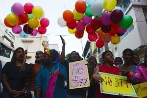 Members of the LGBT community take part in a celebration in Chennai on July 2, 2018, to mark the anniversary of Delhi High Court's verdict amending Section 377 of India's penal code.