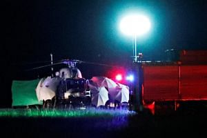 The last helicopter from Tham Luang cave lands at a military airport in Thailand's Chiang Rai province on July 10, 2018.