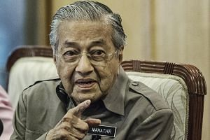 """We have not given them full notice yet but they know what we want to do,"" said Malaysian Prime Minister Mahathir Mohamad."