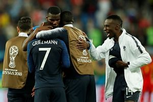 France's Paul Pogba celebrates with Antoine Griezmann, Blaise Matuidi and team mates at the end of the match.