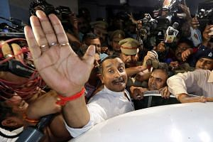 Sengar reacts as he leaves court in April 2018.