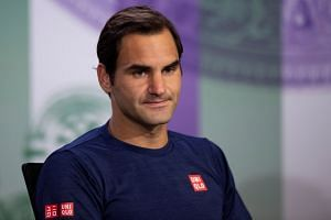 Federer attends a press conference after losing to South Africa's Kevin Anderson.