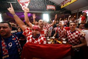 Croatia fans in Zagreb celebrate after Croatia beat England in the World Cup semi-final match on July 11, 2018.