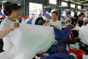 People work in a factory for inflated toys, mainly for overseas markets, in Huaibei city, Anhui province, central China, on July 5, 2018.