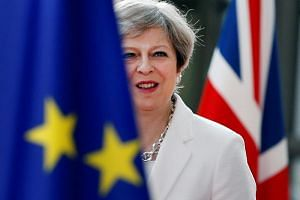 "British Prime Minister Theresa May published a 98-page ""white paper"" setting out in detail the deep trading partnership Britain wants with the EU."