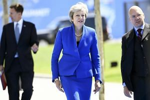 British Prime Minister Theresa May (centre) arrives for a Nato summit in Brussels, Belgium, on July 11, 2018.