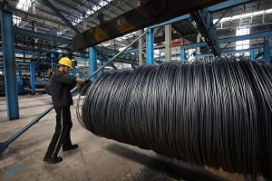 A worker handling steel cable at a steel factory in Lianyungang, in China's eastern Jiangsu province.