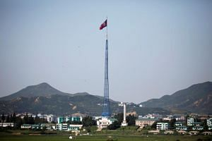 A North Korean flag flutters on top of a tower at the propaganda village of Gijungdong in North Korea, near the truce village of Panmunjom, South Korea, on Aug 26, 2017.